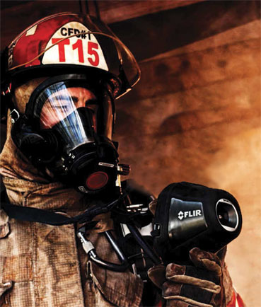 A Fire Fighter at work, using a FLIR K-Series product.