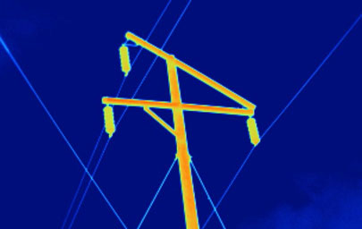 Thermal image of an electrical power line pole with standard lens